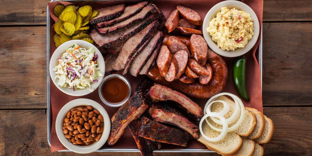 "We serve mesquite-smoked BBQ that doesn't mess around. KLBJ Radio named our wings the best in Austin in 2012, and the accolades don't end there. Customers rave about our tender pulled pork, creamy potato salad, and pecan pie that's ""no lie."" Place your order and find out why we've been an Austin landmark since 1988. - Green Mesquite BBQ & More"