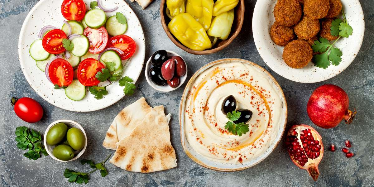 Our traditional Mediterranean menu brings fresh and fun fare to any event. Our entrees are served with a side and salad, so you can enjoy a variety of unique flavors. After one bite of our cuisine, we're sure you'll be coming back for more.  - Ed's Kitchen Catering