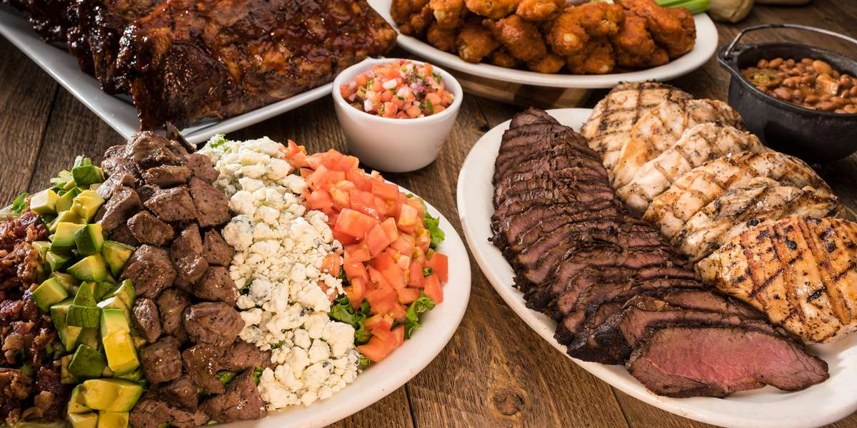 We offer saloon favorites that are sure to take you to the wild West. Share an appetizer of our sizzling steak bites, our classic slow-roasted tri-tip steak, or our raspberry chipotle-glazed ribs. With real steakhouse eats, we know you'll get a true taste of the West.  - Cool Hand Luke's Steakhouse