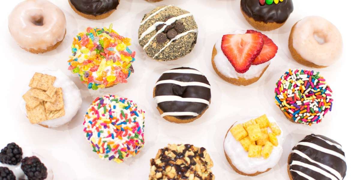 Our mini donuts are dressed to impress. Whether you're looking for classic glazed or unique and exciting flavors, we offer everything needed to satisfy everyone's cravings. Give us a try for sweet, heavenly treats at your next event. - Humble Donut Co.