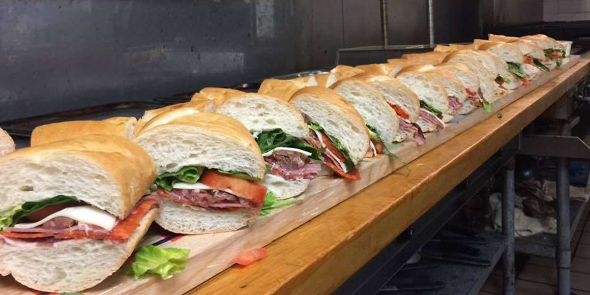 """A taste of the Big Apple in the Big Easy! We offer real New York bagels from H & H, Boar's Head deli meats, and everything your office needs for breakfast or lunch. Customers praise our """"truly excellent food"""" and reasonable prices.  - Empire State Delicatessen"""
