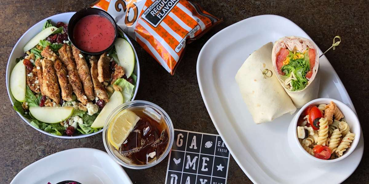 Whether for a game day with friends or a meeting with strangers, we have everyone's favorite meal: chicken! We also offer burgers and wraps. - Gameday Fresh Grill