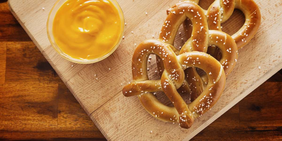 The best things in life are fresh and we bake all our pretzels fresh from scratch every day! Whether it is an original pretzel snack on the go, shareable Cinna-bitz, or a Wetzel Dog, we've got you covered. Something for everyone to grab a little happiness in the palm of your hand. - Wetzel's Pretzels