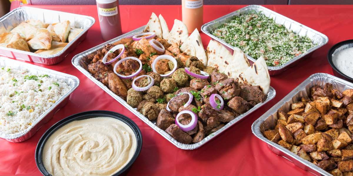 Kebabs & gyros are our specialty. Our passion & authentic recipes, passed down from generation to generation, are what makes our food healthy & a delicious addition to any corporate or private event. We make just about everything from scratch, including the special marinades and spices that make our shawarma and gyro meat tender and juicy. Order our authentic food now and turn your next lunch or dinner into a real experience!  - Flame Cafe & Catering