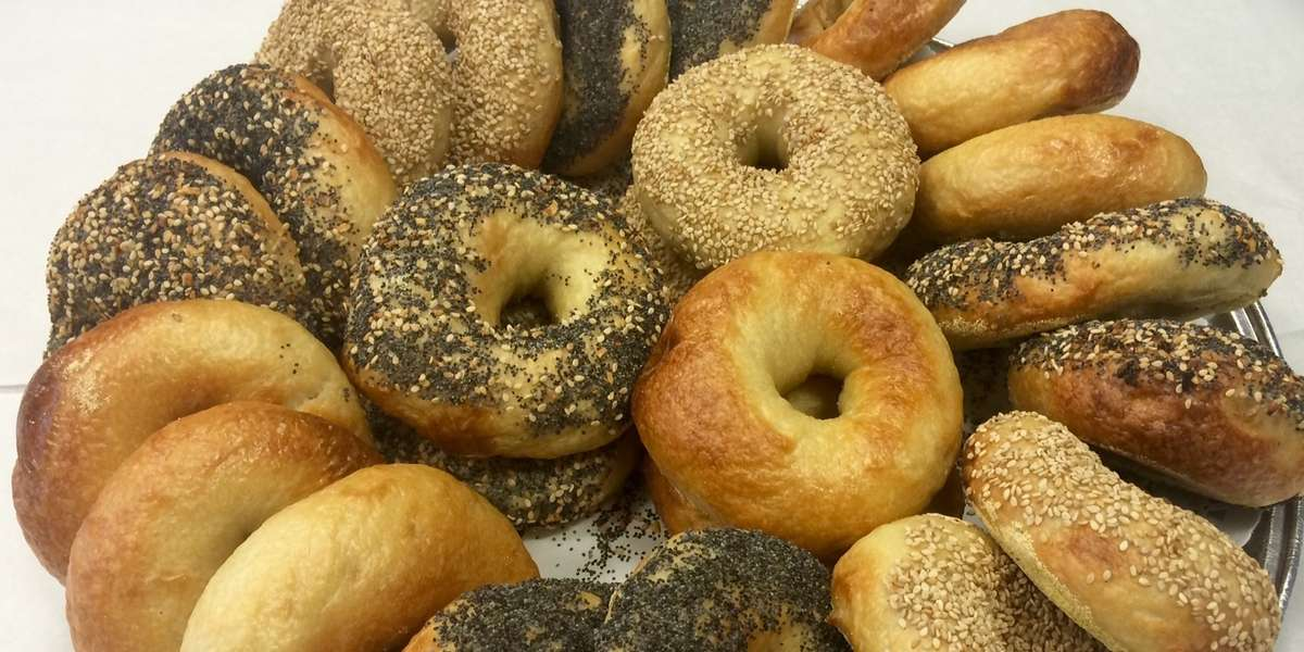 We are a nut-free and kosher bakery best known for our gluten-friendly and vegan options, hand-rolled bagels, award-winning cakepops, and other delectable baked goods. We cater for all types of events that call for desserts- including parties, conferences, receptions and more. Our hand-rolled bagels and spreads are perfect for breakfast meetings. 
