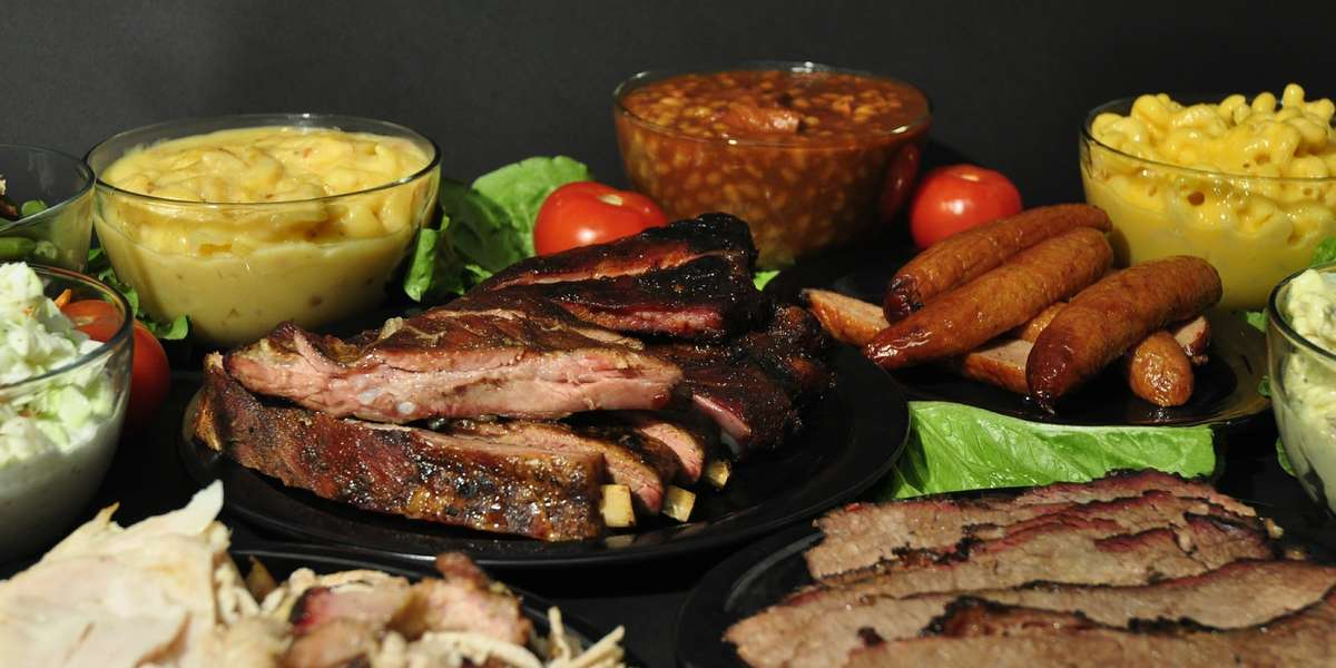 Two Brothers BBQ has been family-owned since 1997. The Brothers offer homestyle barbecue as well as specialty baked potatoes and hand-pattied burgers and all the fixin's. With four locations serving the Wichita area, you are sure to find something to satisfy your crowd! - Two Brothers BBQ