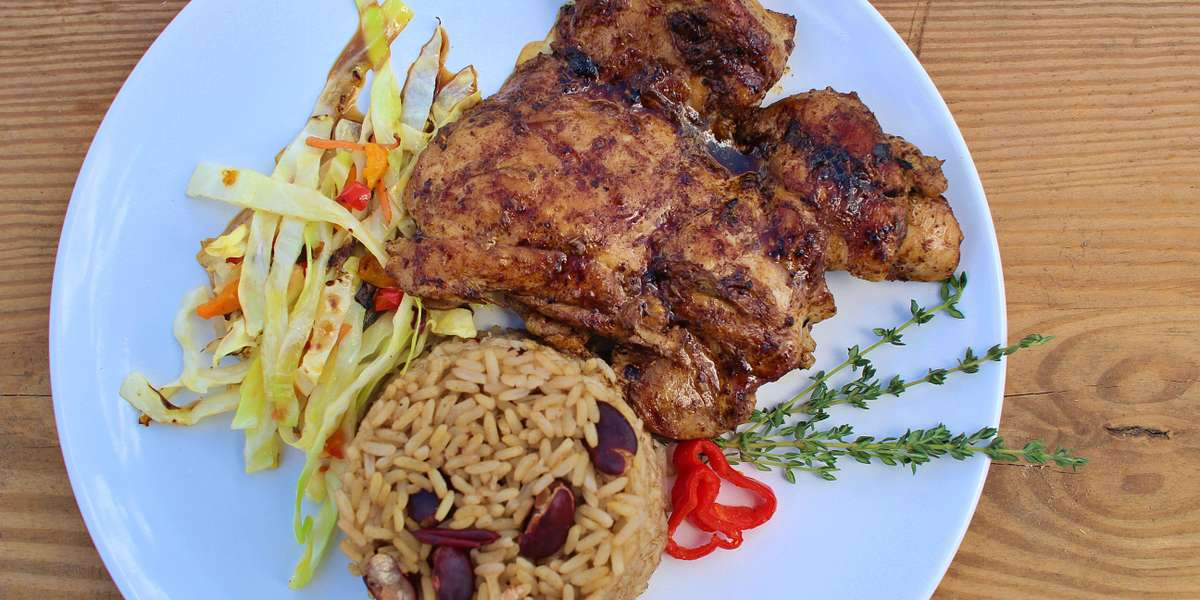 "Why order from us? Because we believe that great food fuels your soul. Chef Christene learned to cook from her Guyanese grandmother, ""Miss Vi."" Nowadays she makes her grandma's jerk chicken, cook-up rice, fried plantains, and more. The tastiest food is made with love, and that's why customers call us the best in Tampa. - Miss Vi's Cook-Up"