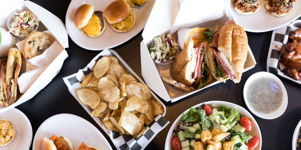 From sandwiches to salads to boxed lunches, we've got you covered for all of your business catering needs! Our boxed lunches include a sandwich, wrap, or salad and your choices of chips, sides, and a cookie. Try us for an easy, no-hassle lunch that will be sure to please. - The Public House