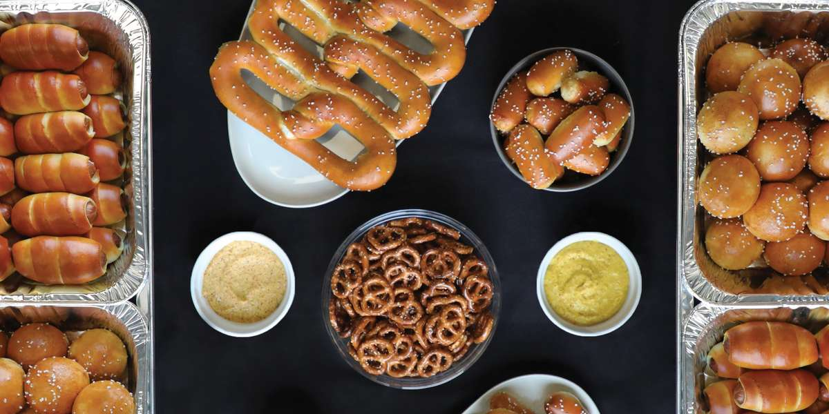 """Founder Dan got his start at age 11, selling pretzels out on the streets of Philadelphia and organizing neighborhood kids to work for him in multiple areas of the city. Now we bring our Philly Pretzel brand to 12 states. Order our """"hot outta the oven"""" soft pretzels and give your office an unexpected treat! - Philly Pretzel Factory"""