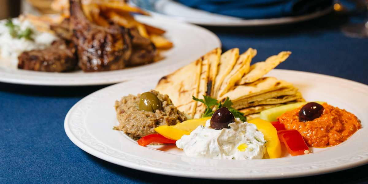 When you eat our authentic Greek food, you'll feel like you're at the top of Mount Olympus. With souvlaki, dolmades, spanakopita, and more on the menu, you'll get a complete Mediterranean meal. One bite, and you'll understand why we're named after the Greek goddess of food! - Estia