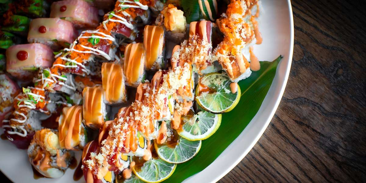 We pride ourselves on world-class Japanese cuisine. We offer a variety of options and sizes based on your meeting. Yelpers love our sushi, especially the white tiger roll! - Drunken Fish