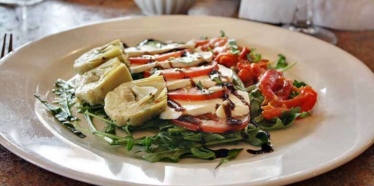 We are a Red Bank staple, holding steady as a local favorite for over 30 years.  We offer an old-world passion for fabulous taste, and authentic recipes brought straight from owner Angela Coccurello's hometown of La Maddalena, Italy. - New Corner Restaurant NJ