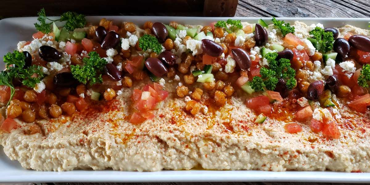 "We are the result of a lifelong labor of love for chef/owner, Nehme Elbitar, and his wife, Christina. Named in honor of his hometown, Chadra, Lebanon, we offer an exceptional sampling of Mediterranean cuisine, in addition to delicious pastas. Having received numerous awards granted by various entities publications, we represent a dining mainstay in the Medical Districts. This is hardly surprising. After all, community is ""our main ingredient."" - Chadra Mezza & Grill"
