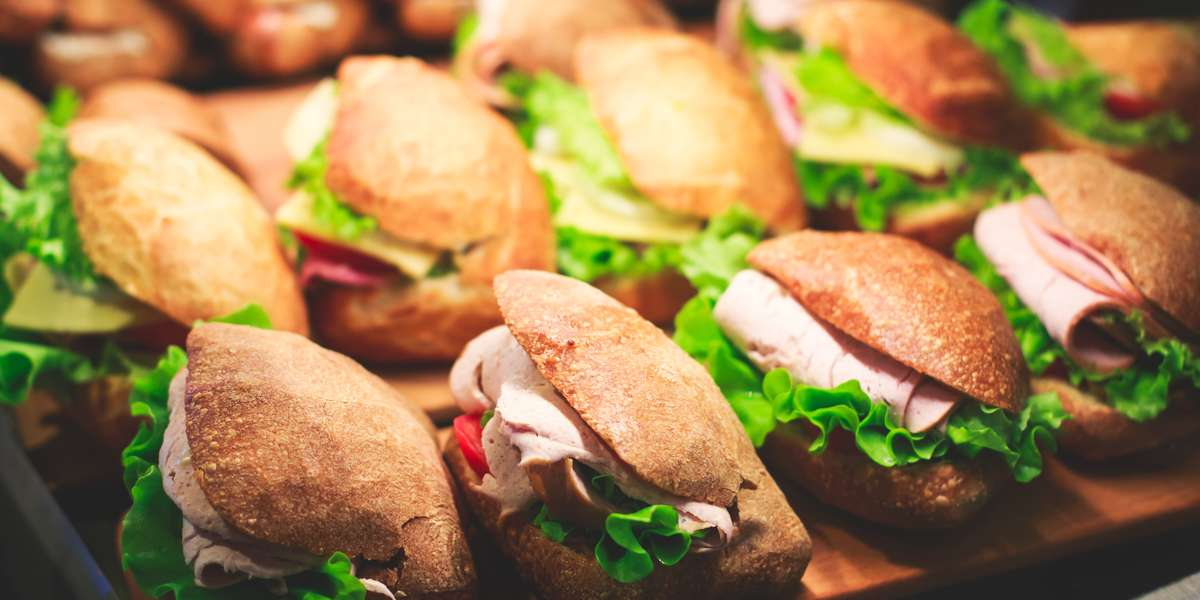 Need lunch delivered to the office? We can help! Our Deli menu is perfect for meetings, seminars, open houses- you name it. We offer boxed lunches, sandwich platters, family-style salads, dessert trays and more.  - 34th Street Cafe & Catering