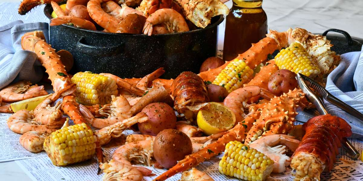 Let us cater your home or office party. Party Platters ~ Box Lunches ~ Group Meals ~ Seafood Boil Packs ~ Whole Desserts and More! We've got you covered. - River Crab
