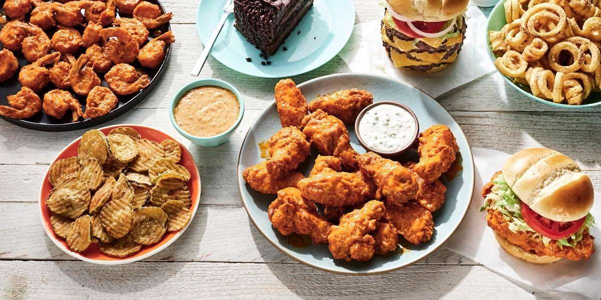 Order your Hooters favorites in a party pack or customize to suit your needs. Our famous Hooters wings with awesome sauces and signature sides are sure to please your group and keep them fueled for action.    - Hooters