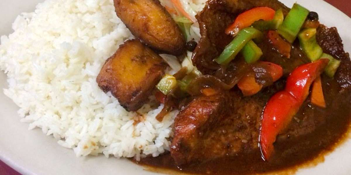 Break up your daily lunch routine with some Jamaican flare! Try one of our classic dishes like our brown stewed chicken or curry goat. End your meal with a taste of our fried sweet bread - your office will thank you. - Boswell's Jamaican Grill
