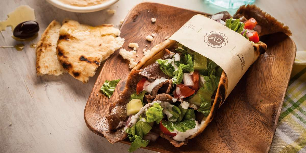 We use recipes that combine old school Greek traditions with a modern day twist. Our menu features ingredients with clean, bold flavors. We offer box lunches, wrap platters, and salad options with both traditional and contemporary Greek specialties.  - Gyroville