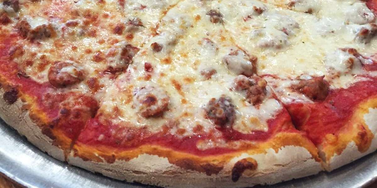 The oldest pizzeria in Evanston! There's a reason we've stuck around so long. We think it's because we make everything fresh onsite, with pizza dough that sits overnight to develop deeper flavors, whole milk cheese, and a sauce that's our best-kept secret. - Gigio's Pizzeria