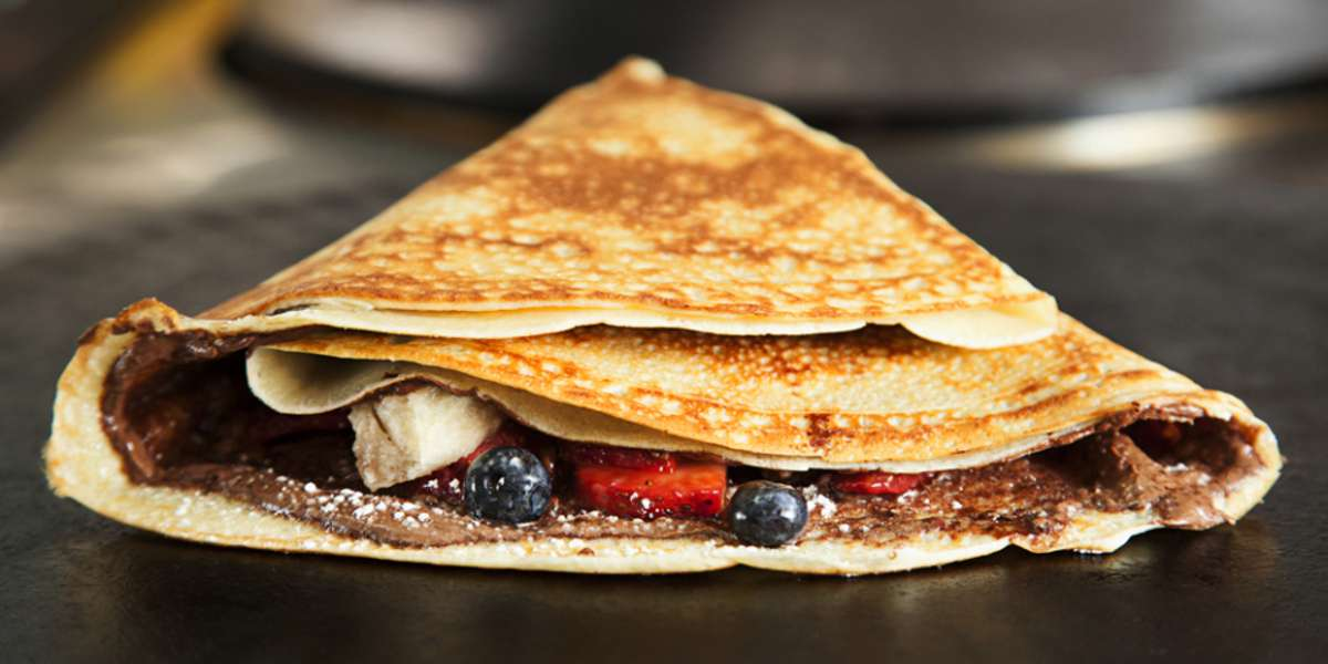 Our batter recipe goes back at least three generations offering you the same delicate taste and texture enjoyed for over a century. Start your work day with a savory, sweet or omelette crêpe accompanied by a steaming cup of coffee. - Bonjour Crepes & Wine