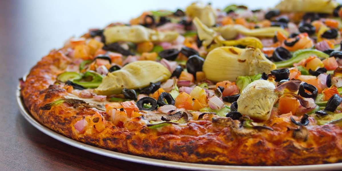 We create unique curry pizzas that combine the distinct flavors of India and Italy. With rich recipes like our curry chicken masala pizza or curry veggie delight pizza, you can get the best of both worlds. Go on a culinary adventure when you order from us!  - Curry Pizza House