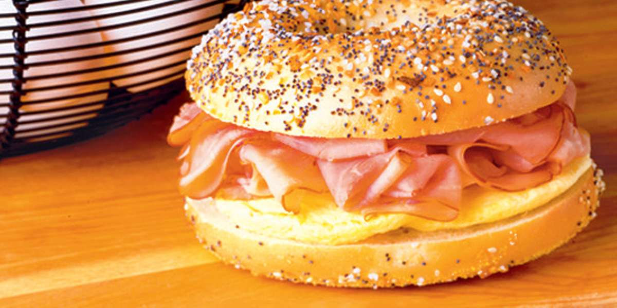 We bake our bagels fresh every single day, so you know you're getting the very best in quality bagels. We also offer salads, panini, and tasty coffee. Don't forget to try a taste of our baklava or tiramisu for dessert! - The Great American Bagel