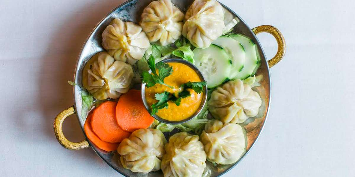 Nepal sits astride the Himalayan mountains. Our cuisine is influenced and augmented by our neighbors: Tibet, Pakistan, India, and Bhutan. On our menu you'll find classic momos and lentils alongside traditional Indian fare like aloo gobi and tandoori chicken. Give your guests a taste of a unique cultural experience.  - Nepal House