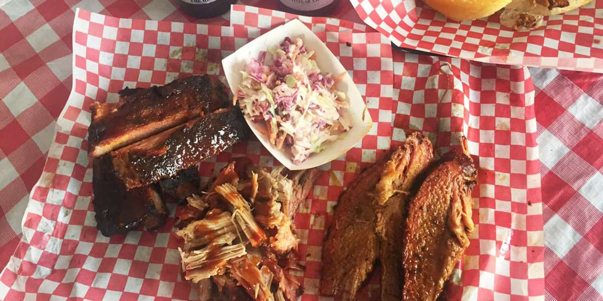 """With over 100 reviews and a 4.5 star Yelp rating, you can bet that our catering packages are jam-packed with some of the best BBQ around. Not only that, our """"God sauce"""" took Best BBQ sauce in Las Vegas for 2016 by Las Vegas Weekly! - Jessie Rae's BBQ"""