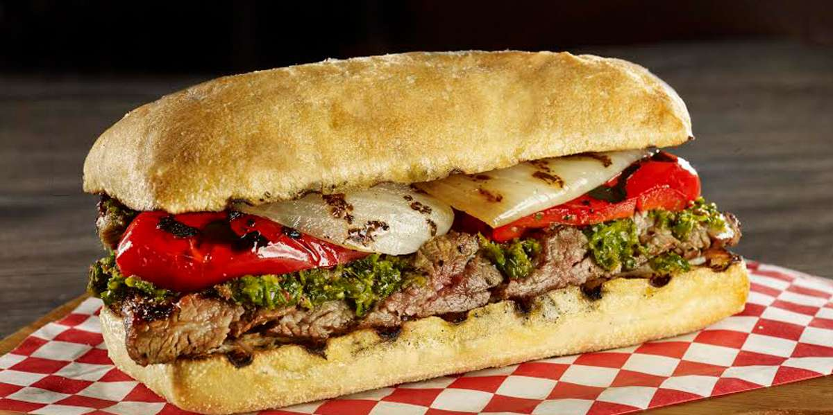 We offer a completely unique dining experience. We combined juicy cuts of steak found in Brazilian steakhouses with a delicious ciabatta bread, forming the best steak sandwiches you will ever taste! We also serve steak, chicken, and lamb entrees as well as delicious salads.  - Steak on Fire