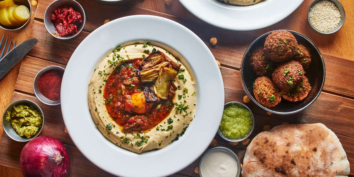 We serve a range of Mediterranean and Middle Eastern favorites, from sabich pita to shakshuka. But our hummus bowls are what define us. Our hummus is made fresh every day from organic & GMO-free ingredients. Enjoy it alone or try it with toppings like chickpeas, eggplant, cauliflower, and more.  - The Hummus Factory