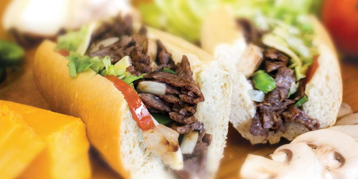 We're what happens when you combine the soul of South Philly cheesesteaks with a passion for serving great food. Our cheesesteaks and sandwiches are all hand-sliced, freshly prepared and made-to-order. We're not just a place to get a great meal, it's a place that will make a difference in your day.  - Steak Escape
