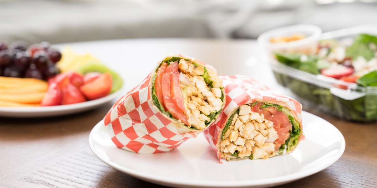 Where fresh and healthy meets fast! Our hand-held, better-for-you lunches are just what your next event needs. Try our spicy Jerkin' Me Crazy or our healthy black bean burger wrap for a lunch your office won't forget. - It's A Wrap Cafe