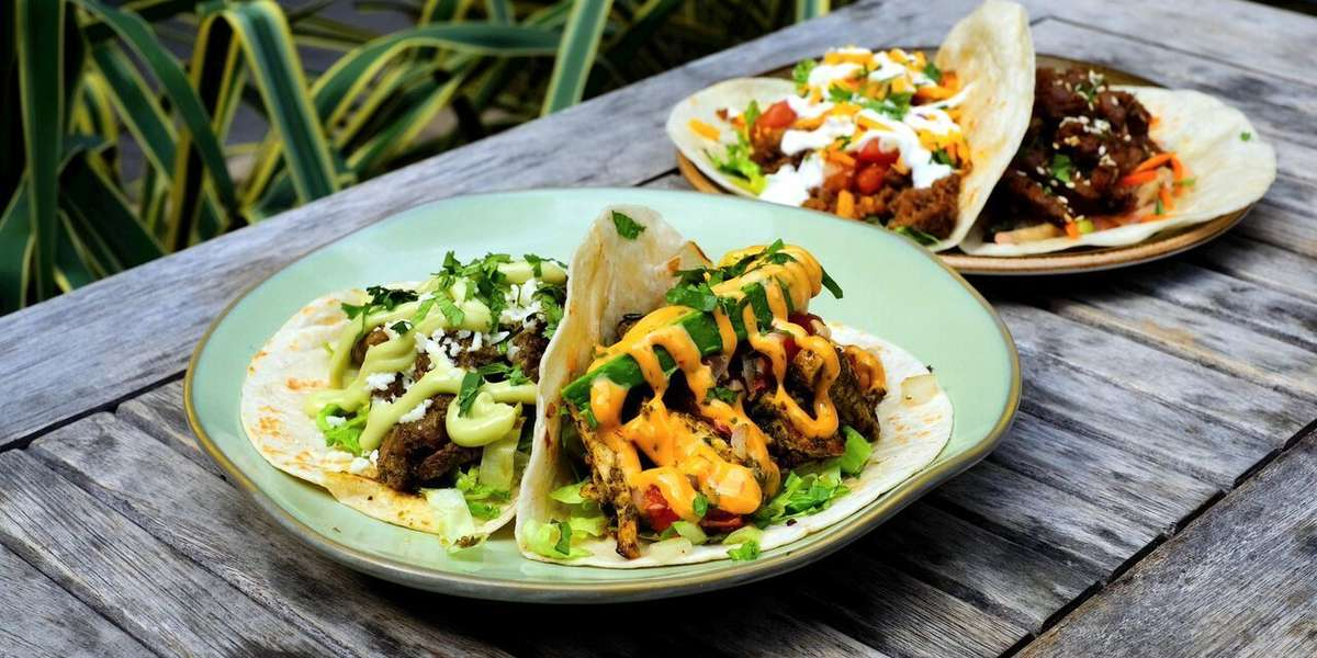 """Our menu offers swanky street taco platters with all of the fixins, burritos, and traditional appetizers & sides. Order some of our tacos for your next corporate event and find out why we were named one of """"Charlotte's Top 10 Places for Tacos!"""" - RuRu's Tacos & Tequila"""