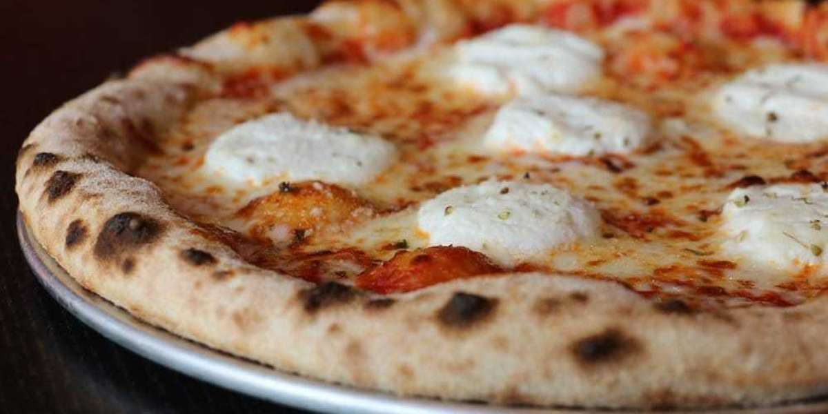 "Our ovens are cranked up to exactly 1000° to produce true Neapolitan-style pizza in just two minutes per pie. Our authentic dough is made from a centuries-old recipe for a crispy, airy, thin crust with inspired sauces and toppings. That's why our customers say ""You had me at first bite!"" - 1000 Degrees Pizza"