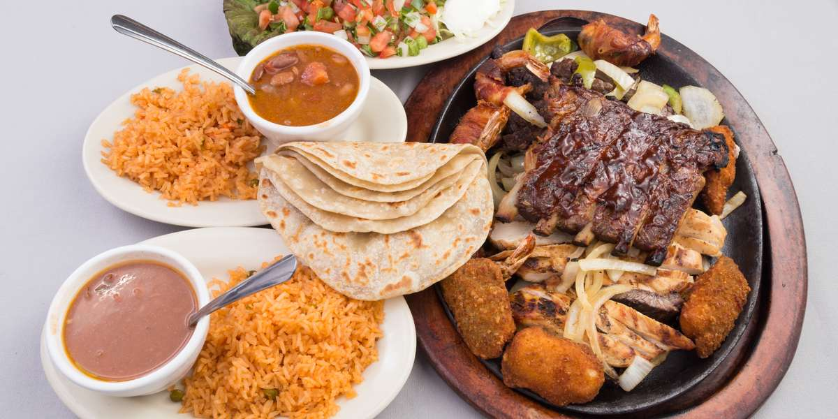 We feature classic Mexican dishes that will transport you straight across the border! Our menu includes easy-to-order catering packages that are perfect for any size group. Try our fajita package at your next event! - Las Haciendas Mexican Bar & Grill