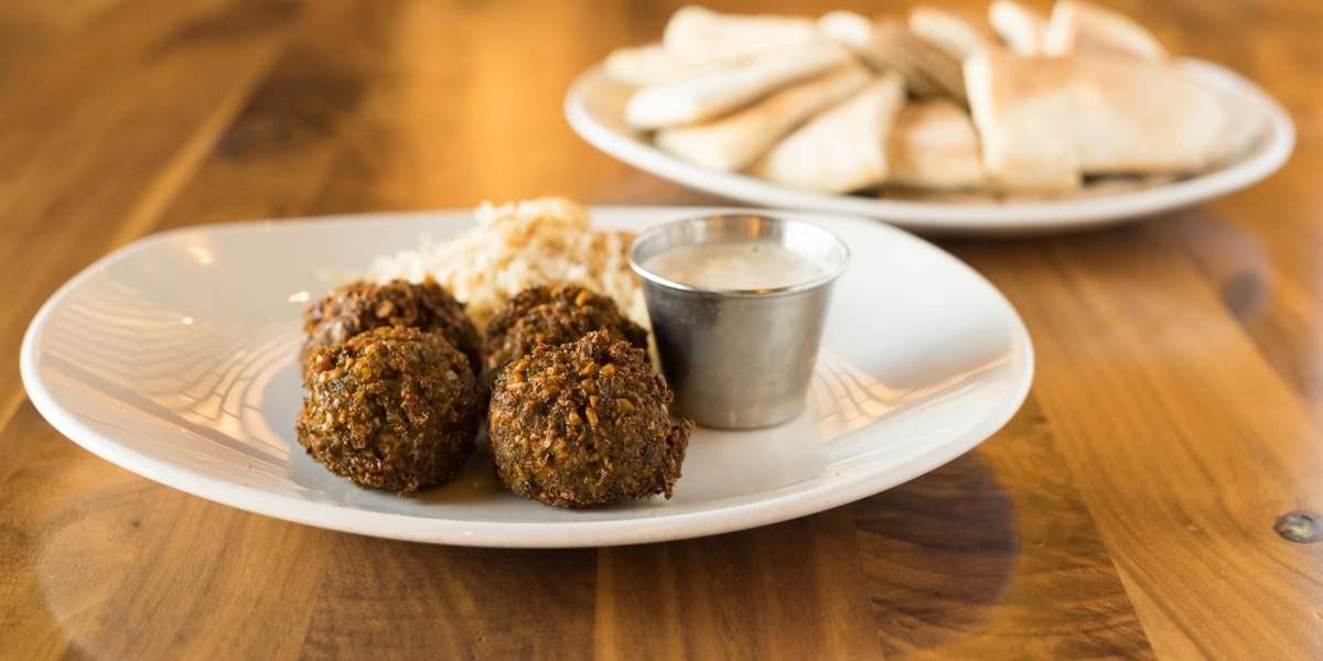 "We're a fast-service, from-scratch kitchen. Our philosophy is simple: we believe that fine food shouldn't be limited to fine dining. Chicago Magazine and TimeOut Chicago both called our falafel sandwich the best in the city and CBS Chicago called us ""hands down, one of the best falafel places"" around. Try us for yourself! - Falafill"