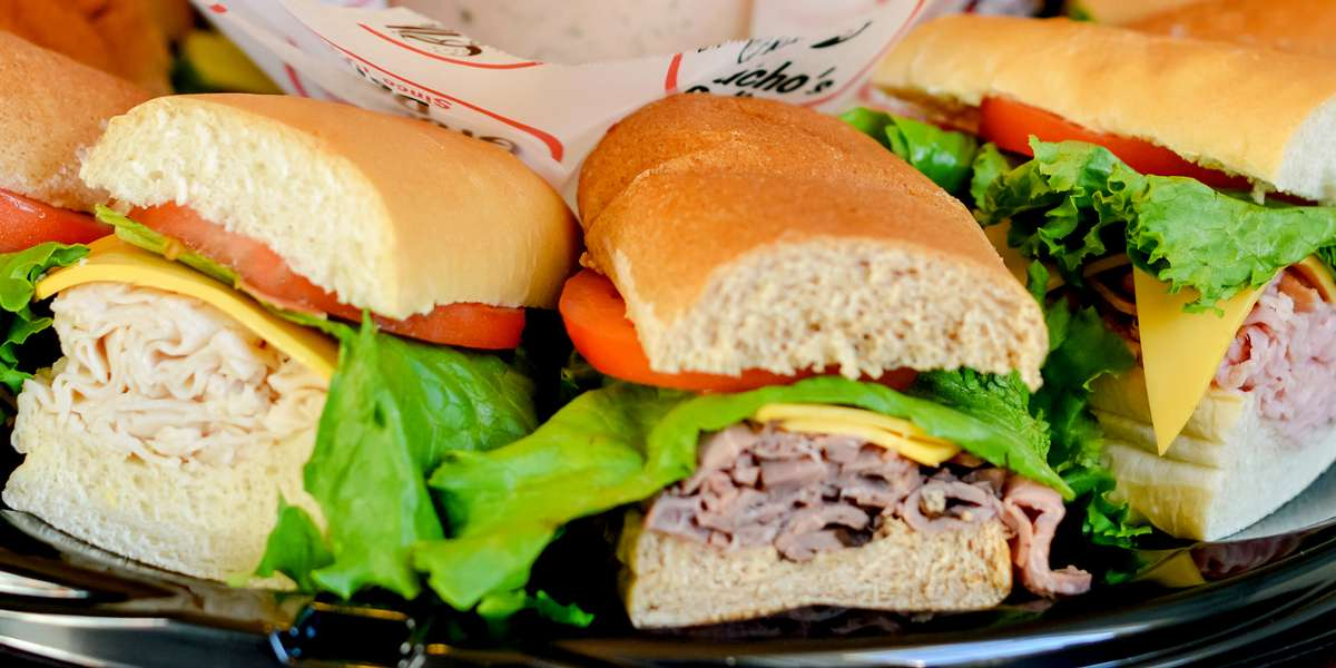 Fast. Fresh. Original. With crowd-pleasing sandwiches such as the STP, Apollo, and Big Dipper, your next catered event is guaranteed to be a hit! For office luncheons and meetings, count on us- we have over 70 years of experience within the deli business! - Groucho's Deli