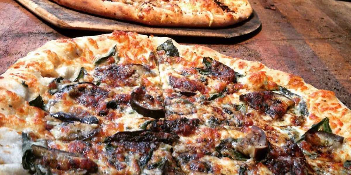 For over 15 years, we have used organic and locally sourced ingredients to provide New England with delicious flatbreads. Our hand-crafted pizzas are sure to be a hit at your next party or event! - Flatbread Company