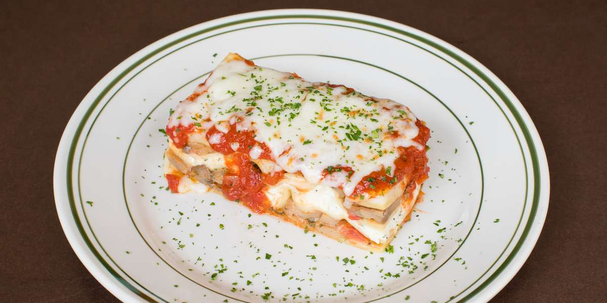 """We have been serving tantalizing Italian and Mediterranean offerings for over 30 years! We have customers who've been with us from the beginning. That loyalty is thanks to our """"legendary"""" lamb gyros, top-notch pizza, and garlic knots that are sure to hit the spot. - Acropolis Pizza Cafe"""