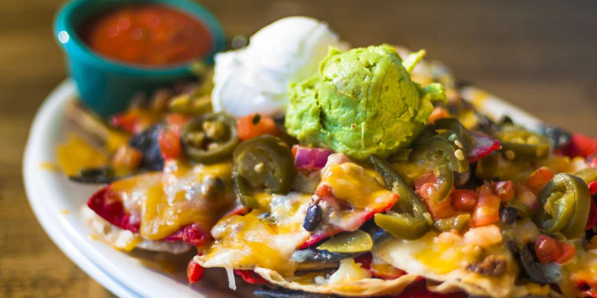 Unlike any other business in the area, this is where East Bawmer meets Mexico. Opened by an Irishman, our Tex-Mex catering is a Maryland area favorite. Try our crunchy nachos, our tasty taco bars, and order one of our delicious desserts! - Nacho Mama's
