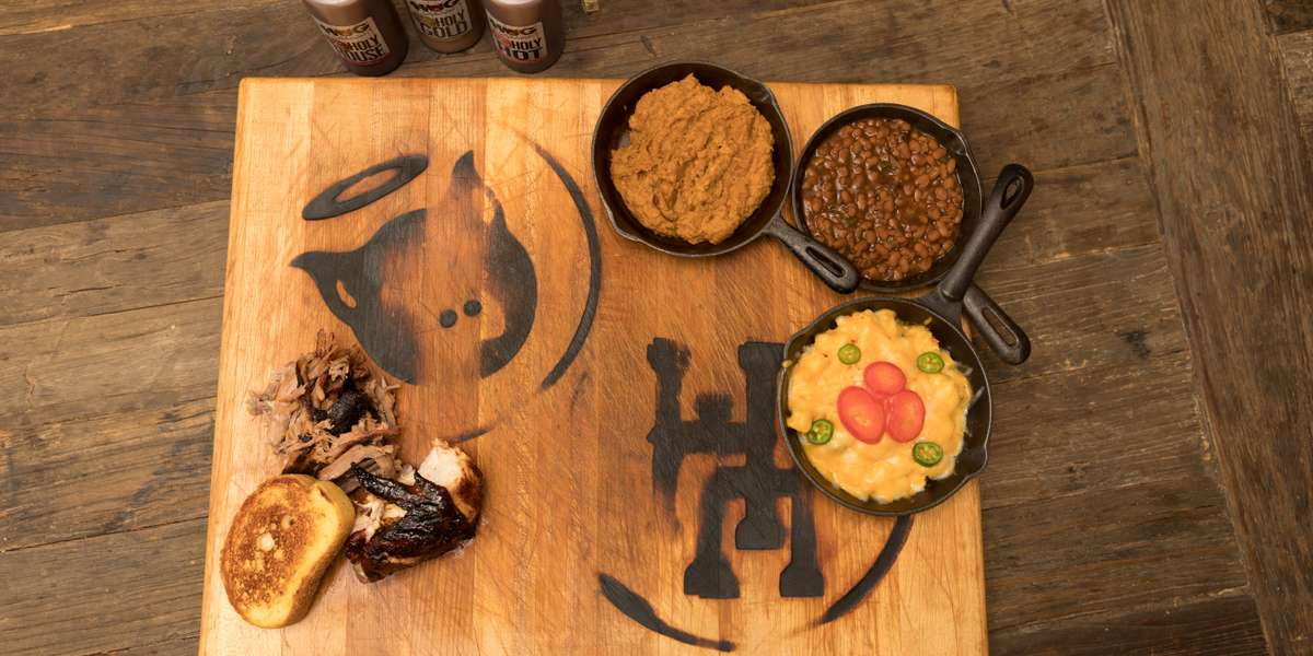 Since 2010, we've made a real name for ourselves in the Tampa area. Our ribs, brisket, and signature jalapeño mac & cheese have won awards and accolades. Customers say our flavors are out of this world. When you experience our smoked meats, you'll understand what makes the hog so holy. - Holy Hog BBQ
