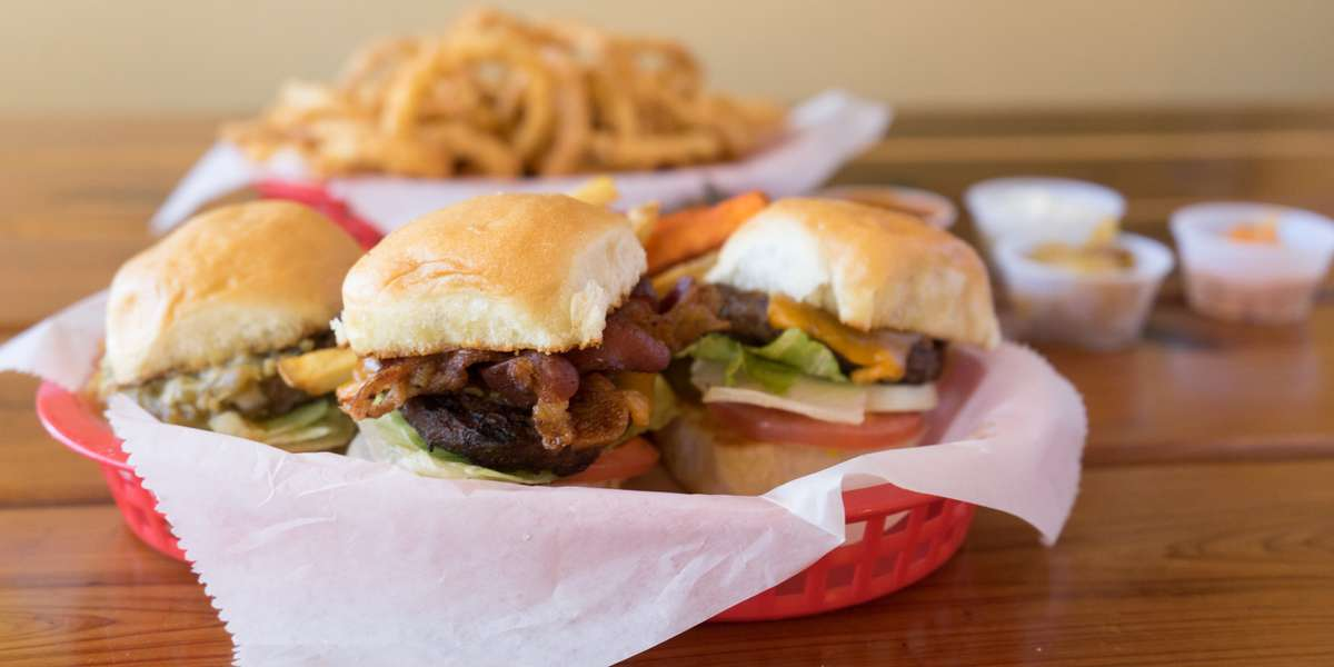 A few years ago we started a journey to build the BEST burger around. We went to the top-rated burger spots and figured out the things we liked and the things others raved about. Try our 78704 burger with Monterey Jack, guacamole, grilled onions and jalapeños-- customers say it's just about perfect. - Phil's Ice House