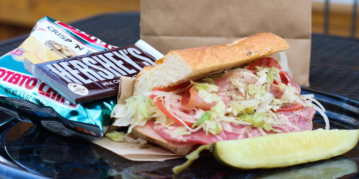 Get ready for some east coast-style hoagies, pretzels, and pickles! Craft your meal from the very beginning, or grab a brown bag lunch that has all you need-- your favorite hoagie, chips, pickle and a Hershey chocolate bar. It doesn't get much more Pennsylvania than this. - Hoagies & Hops