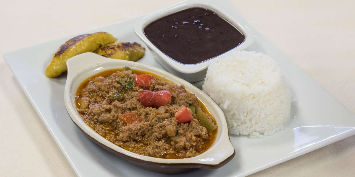 """We're proud to prepare authentic Cuban cuisine from scratch. We're prouder that our hard work pays off: customers say our food is """"exceptional,"""" from the cheese croquettes to the pollo asado. Order a little bit of Island flavor to liven up your next event. - Mojito Cafe"""