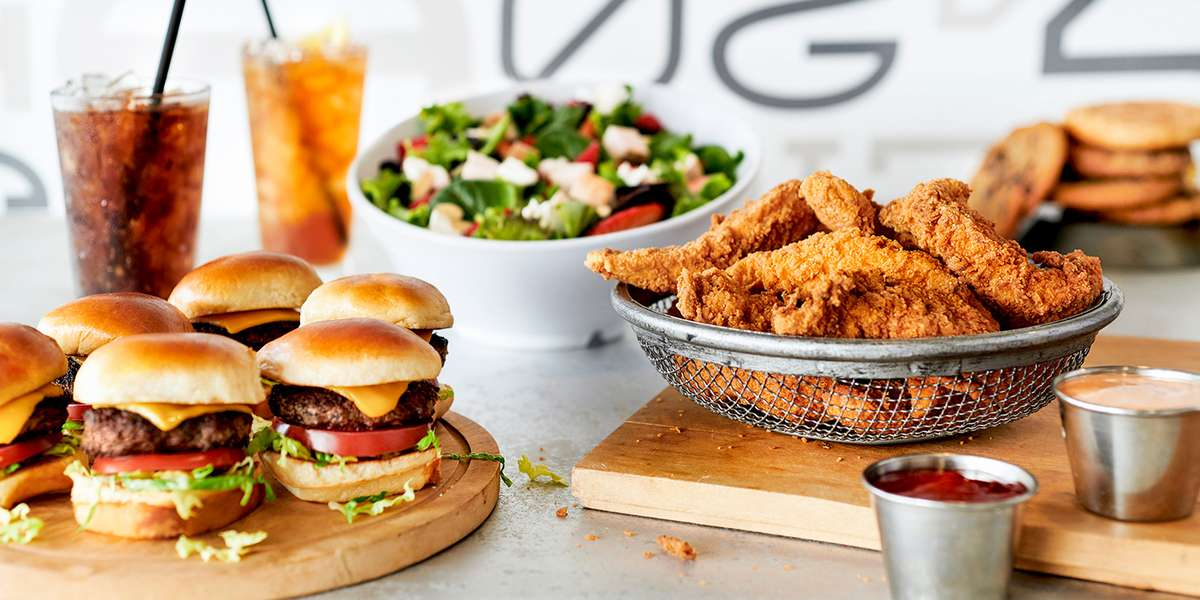 Let us do all the work while you take all the credit. Our unique slider creations are surefire crowd-pleasers. Our fresh salads, gourmet cookies, and house-made chips will have your guests raving. Order from us because life is too short for boring burgers! - Burger 21