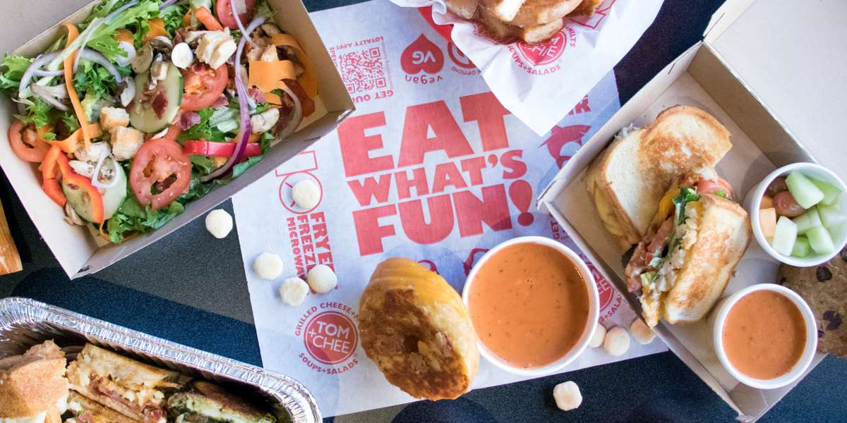 """Tom & Chee is an innovative restaurant chain that offers a unique menu based off of the classic meal, Grilled Cheese and Tomato Soup. What began in a small tent next to an ice-skating rink in Cincinnati's Fountain Square quickly but quietly grew to multiple stores in the Cincinnati market, and they began franchising. Tom & Chee has been featured on ABC'sShark Tank, The Chew, The Travel Channel's Man vs. Food Nation,Amazing Eats. The Today Show named their Grilled Cheese Donut one of the """"Best Sandwiches in America."""" Our Handcrafted Melts & Soups & Salads are the perfect union of unique flavor combinations and familiar comfort foods that hit the spot, every time. Everything we bring together results in something incredible made possible by the power of """"and."""" For more information, visitwww.tomandchee.com. - Tom & Chee"""