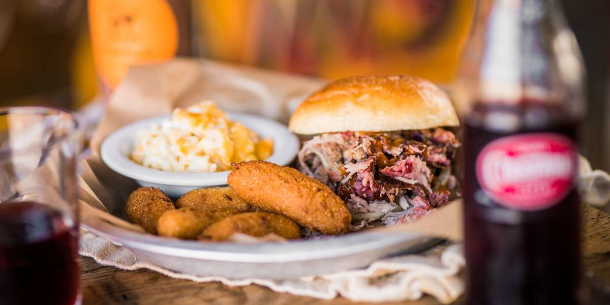 Since 2007, we've been serving up hearty BBQ dishes made from recipes handed down throughout the generations. We've taken the time to perfect our process, from our slow-roasted meats down to our house-made sauces. If you're looking for some mouthwatering dishes served with simple but delicious sides, you've come to the right place! - Luella's Bar-B-Que