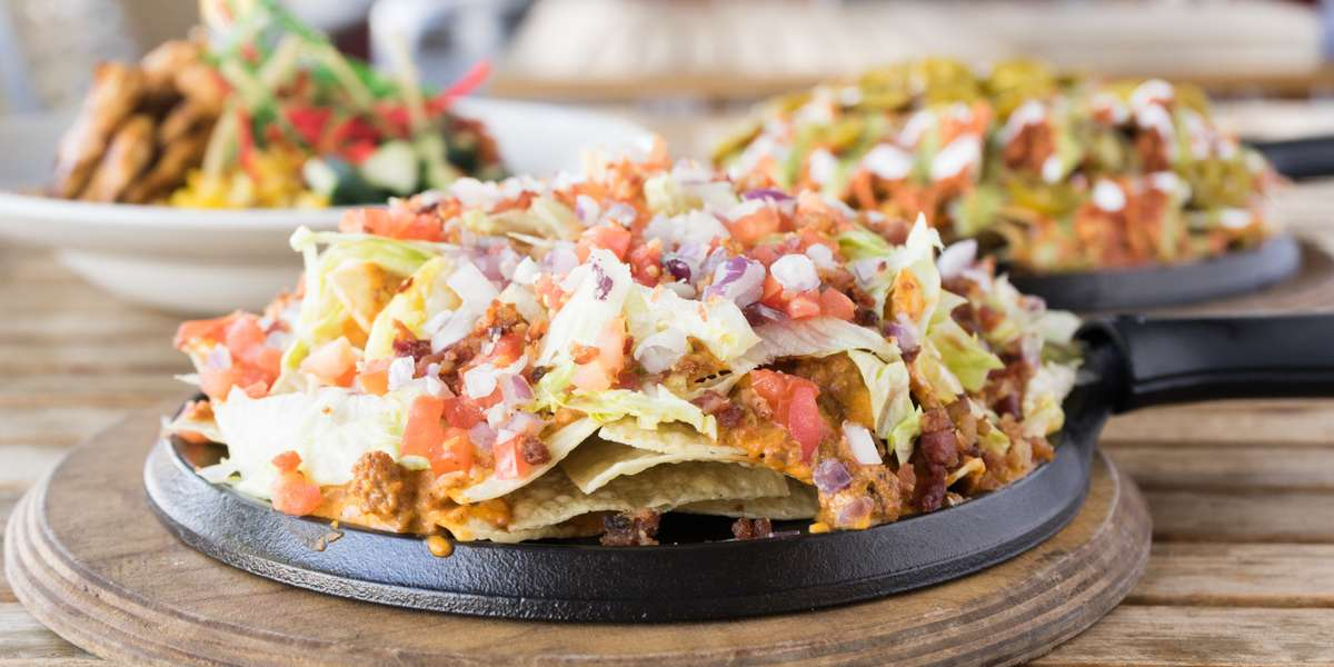 We don't serve just regular nachos — we serve the most insane gourmet nachos smothered in queso that we guarantee you'll never find a dry chip. If nachos are nach-yo thing, no worries! We have something for everyone, including all-day breakfast, Mexican-American collisions, and vegan, vegetarian & gluten-free dishes. - Nacho Daddy