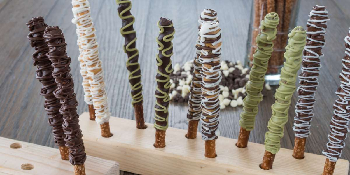 """We specialize in gourmet chocolate-covered pretzel sticks. Crispy, crunchy, and above all chocolatey, our treats elevate simple pretzel sticks to something much more. Customers claim ours are the """"best pretzels in the universe."""" - Doki Doki Chocolate"""