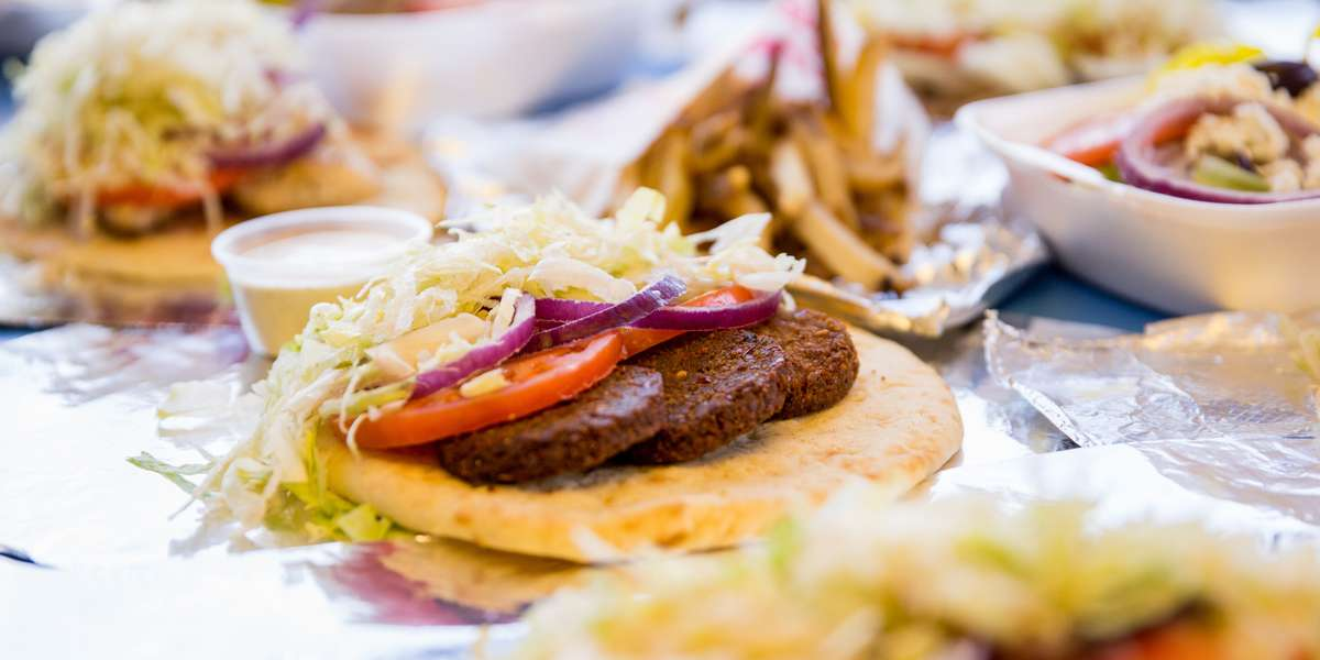 We're the go-to spot in the neighborhood for gyros and fresh-cut fries. Yelpers say our meat is cooked perfectly every time, and smothered in our tasty sauce. Don't forget to try our baklava-- it's a customer favorite! - The Gyro Shoppe